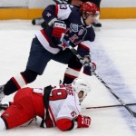 SKA St. Petersburg's Shitikov fights for the puck with Carolina Hurricanes' LaRose during their international friendly ice hockey game in St. Petersburg