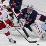 SKA St. Petersburg's goalie Nabokov makes a save on Carolina Hurricanes' Dalpe during their international friendly ice hockey game in St. Petersburg