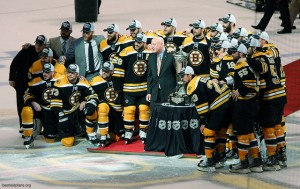 The Bruins celebrate around (but don't touch!) the Prince of Wales trophy.