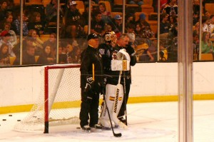 Tuukka Rask and coach Claude Julien enjoy watching everyone else skate.